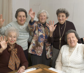 group of elderly woman smiling at the camera