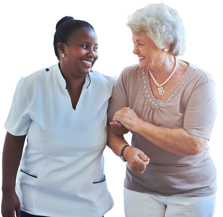 caregiver and an elderly woman chatting while walking