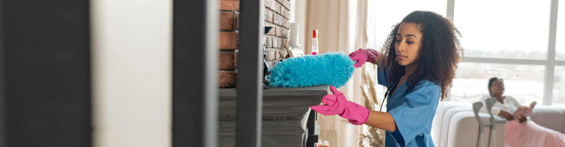 caregiver cleaning the house