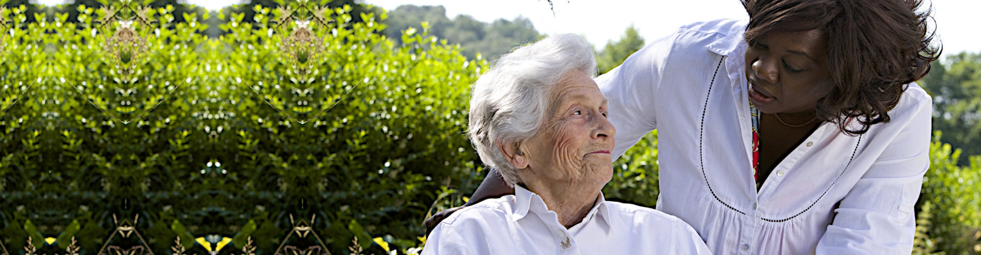 caregiver and an elderly woman chatting